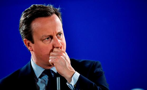 British Prime Minister David Cameron addresses the media in Brussels last night. Getty Images