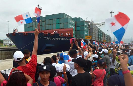 Chinese-chartered merchant ship Cosco Shipping Panama crosses the new Agua Clara Locks during the inauguration of the expansion of the Panama Canal in Colon, 80 km from Panama City
