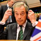 Leader of the UKIP Nigel Farage prepares himself during a special session of European Parliament in Brussels. AP Photo/Geert Vanden Wijngaert