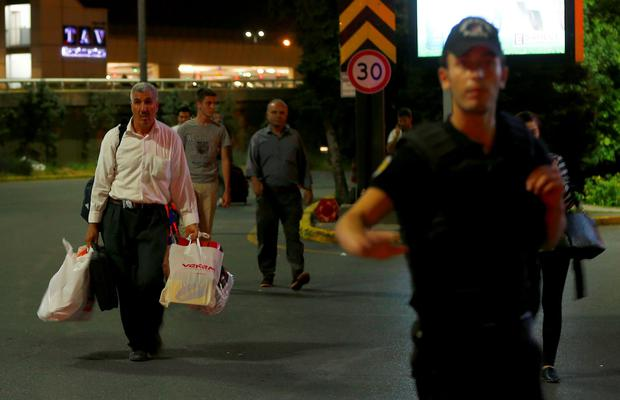 People leave Istanbul's Ataturk airport after the attack