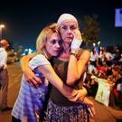 Passengers embrace each other as they wait outside Istanbul's Ataturk airport following the blasts. Photo: AP