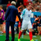 England's Wayne Rooney (right) shakes hands with manager Roy Hodgson after being substituted during the Round of 16 match at Stade de Nice
