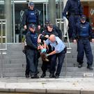 A woman is forcibly removed by a large number of Gardai at the CCJ Dublin. Pic: Justin Farrelly.
