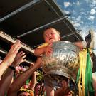 1 August 1999: Two year old Cormac Maguuire from Slane is lifted in the Leinster Football Championship Trophy by the Meath captain Graham Geraghty. Meath v Dublin, Leinster Football Final, Croke Park, Dublin. Picture credit; Brendan Moran/SPORTSFILE