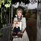 Christina Donnelly holding a photo of her deceased son Brendan (Photo: Mark Condren)