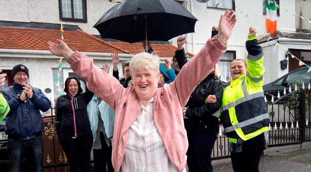 Missing woman Karen Scott is welcomed home in Finglas by members of her search party. Photo: Tony Gavin