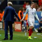 NICE, FRANCE - JUNE 27: Wayne Rooney of England shakes hands with Roy Hodgson manager of England after being replaced during the UEFA EURO 2016 round of 16 match between England and Iceland at Allianz Riviera Stadium on June 27, 2016 in Nice, France. (Photo by Lars Baron/Getty Images)
