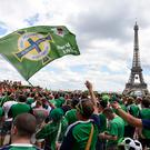 PARIS, FRANCE - JUNE 25: Northern Ireland fans at the The Eiffel Tower before the UEFA Euro 2016 Round of 16 match between Wales and Northern Ireland at Parc des Princes on June 25 in Paris, France. (Photo by Michael Cooper/Getty Images)