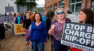 Members of the public protest against the introduction of pay-by-weight bin charges in Tallaght, Dublin.