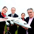 City Jet cabin crew members Fiona Phelan and Lisa O'Brien, with Republic of Ireland team manager Martin O'Neill City Jet executive chairman Pat Byrne pictured as the airline was appointed the Official Airline of Football Association of Ireland.