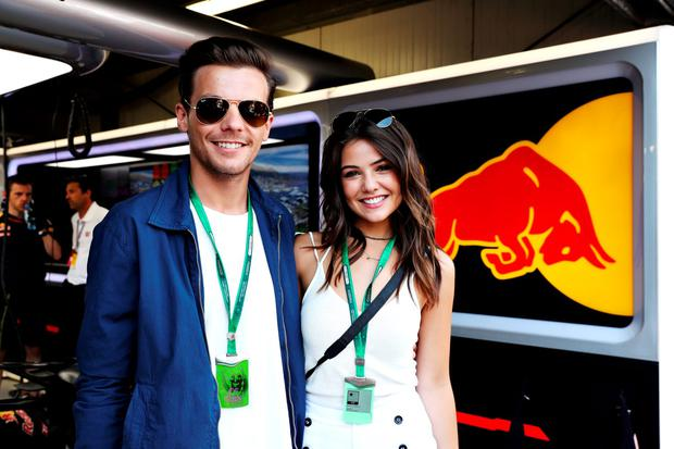 Louis Tomlinson, singer, with girlfriend Danielle Campbell at the Red Bull Racing garage during qualifying for the Monaco Formula One Grand Prix at Circuit de Monaco on May 28, 2016 in Monte-Carlo, Monaco. (Photo by Mark Thompson/Getty Images)