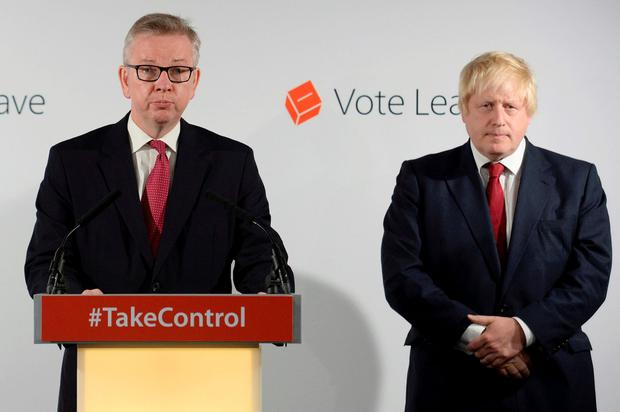 Britain's Justice Secretary Michael Gove (L) speaks as Vote Leave campaign leader Boris Johnson listens at the group's headquarters in London, Britain June 24, 2016. REUTERS/Stefan Rousseau/Pool/File Photo