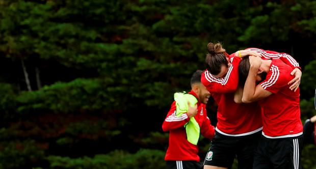 Gareth Bale and Joe Ledley share a joke during training ahead of tonight's game against Belgium. Picture credit: REUTERS/Gonzalo Fuentes