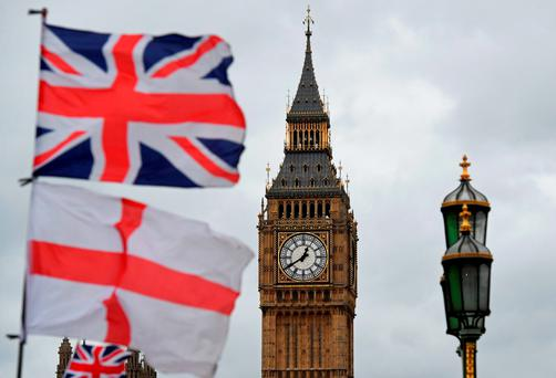 A union flag flies above an English St George's Cross flag near Big Ben Picture: AFP/Getty Images