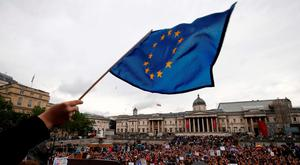 A demonstrator waves a European flag as people gather for an anti-Brexit protest in Trafalgar Square in central London on Tuesday Picture: AFP/Getty Images