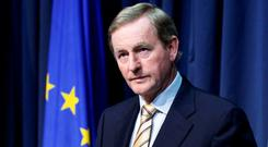 Taoiseach Enda Kenny spoke in slow motion; his face ashen beneath the make-up. Behind the scenes, officials scattered to compose briefing papers for ministers soon to be pressed for intelligent answers Photo: Tom Burke