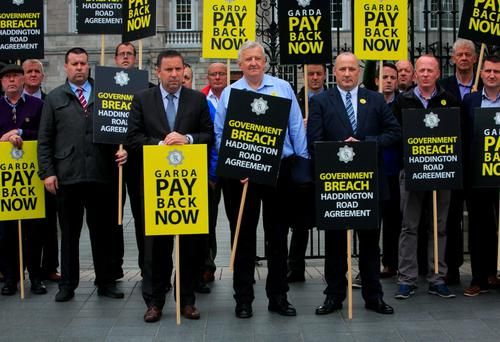 Garda Representative Association members, including deputy president Jim Mulligan, acting secretary Donal Flannery, and GRA president Ciaran O'Neill, protest about garda salaries at Leinster House yesterday Photo: Gareth Chaney, Collins