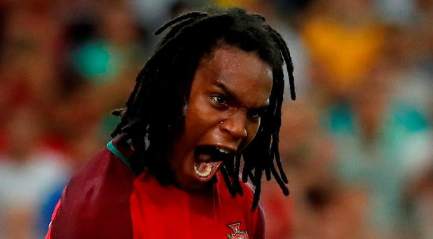 Portugal's goalscorer in normal time Renato Sanches celebrates after hitting the net in the penalty shootout against Poland last night. Picture credit: REUTERS/Kai Pfaffenbach