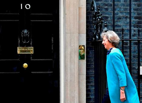 British Home Secretary Theresa May arrives to attend a cabinet meeting at 10 Downing Street Photo: Getty Images