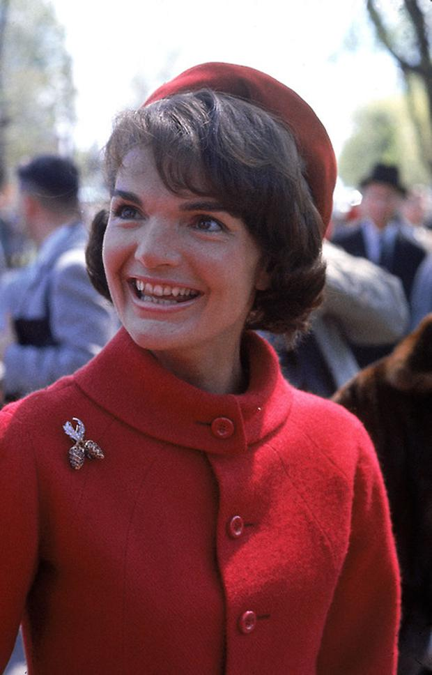 1961: US First Lady Jackie Kennedy, in red wool suit and beret designed by Oleg Cassini, on a trip to Canada. (Photo by Leonard McCombe/Time Life Pictures/Getty Images)