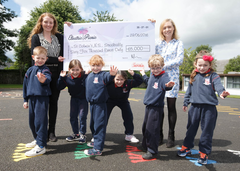 Teachers and pupils at St Colman's with the cheque from Electric Picnic