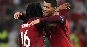Portugal's midfielder Renato Sanches (L) celebrates with Portugal's forward Cristiano Ronaldo after scoring during the Euro 2016 quarter-final football match between Poland and Portugal at the Stade Velodrome in Marseille on June 30, 2016. / AFP / FRANCISCO LEONG (Photo credit should read FRANCISCO LEONG/AFP/Getty Images)