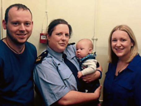Baby Senan with Garda Judy Davern and his mum Jennifer and Dad Jason in Carrick-on-Suir Garda Station