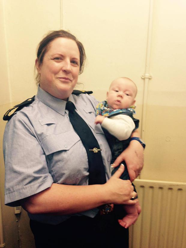 Baby Senan with Garda Judy Davern in Carrick-on-Suir Garda Station
