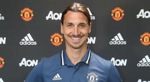 Zlatan Ibrahimovic poses with the Manchester United kit