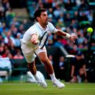 Novak Djokovic lunges for the ball against Sam Querrey on day Five of the Wimbledon Championships at the All England Lawn Tennis and Croquet Club, Wimbledon. Steve Paston/PA Wire