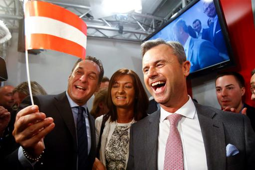 Presidential candidate Norbert Hofer (R) and head of the Austrian Freedom party Heinz-Christian Strache (L) react at the party headquarters in Vienna. REUTERS/Heinz-Peter Bader/File Photo