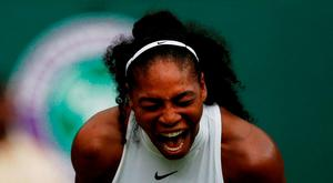 US player Serena Williams reacts while playing US player Christina McHale during their women's singles second round match on the fifth day of the 2016 Wimbledon Championships at The All England Lawn Tennis Club in Wimbledon