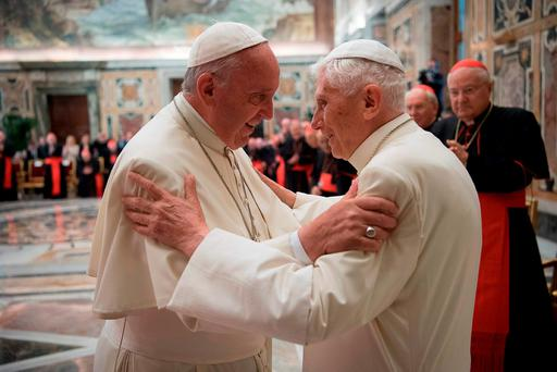 Pope Francis and retired Pope Benedict XVI embrace during a ceremony to celebrate the 65th anniversary of Pope Benedict's ordination as a priest, in the Clementine Hall of the Apostolic Palace at the Vatican this week. Photo: AP