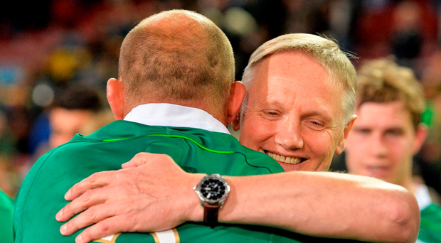 Head coach Joe Schmidt, pictured celebrating Ireland's first Test victory over South Africa with captain Rory Best, will consider his future with the national side during his trip home to New Zealand. Photo by Brendan Moran/Sportsfile