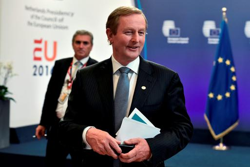 Enda Kenny, here leaving after the EU Summit in Brussels on Wednesday, looks set to stay on longer as Taoiseach as a consequence of the 'Brexit' vote. Photo: Reuters/Eric Vidal.