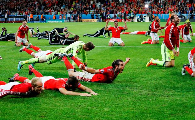 The Wales team celebrate after their stunning victory. Photo: Reuters