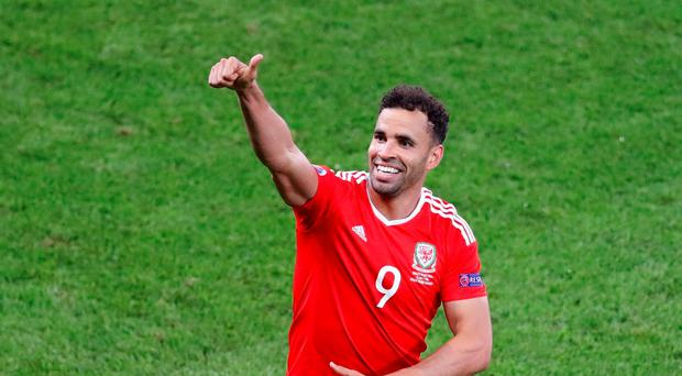 Hal Robson Kanu gives a thumbs up after scoring Wales' second goal. (AP Photo/Michael Sohn)