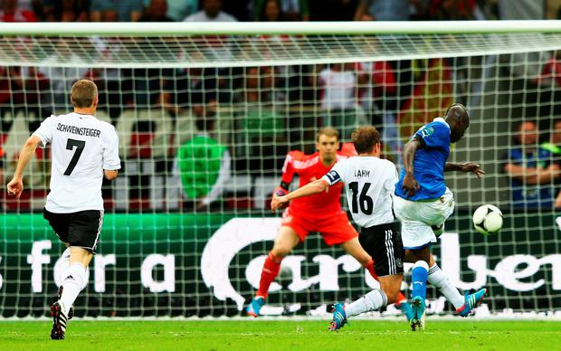 Italy's Mario Balotelli battles with Philipp Lahm as he scores his team's second goal past Manuel Neuer of Germany during the EURO 2012 semi final match. Photo by Michael Steele/Getty Images