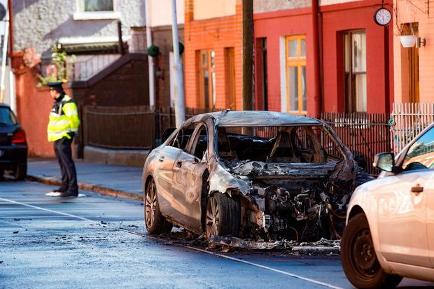 A car which was found burnt out at Spitalfields, in the Liberties. Picture: Arthur Carron