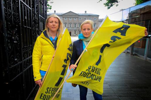 Members of the ASTI Noelle Moran and Denise Hughes during a protest outside the Dáil yesterday. Photo: Collins