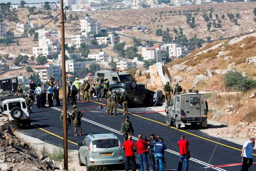 Israeli soldiers secure the scene of a shooting attack near Hebron. (AP Photo/Nasser Shiyoukhi)