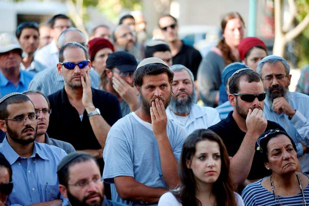 Relatives and friends attend the funeral of Israeli girl, Hallel Yaffa Ariel, 13, who was killed in a Palestinian stabbing attack in her home in the West Bank Jewish settlement of Kiryat Arba. REUTERS/Ronen Zvulun