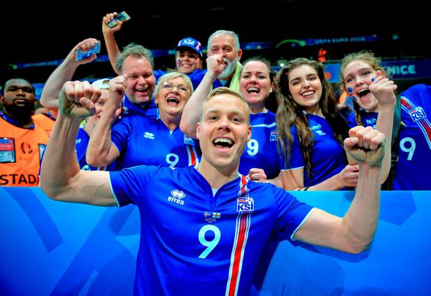 Iceland's Kolbeinn Sigthorsson celebrates victory with fans after scoring the winner against England. Photo: PA