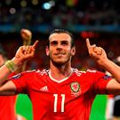 Gareth Bale celebrating at Stade Pierre-Mauroy after Wales' famous victory. Photo by Stu Forster/Getty Images