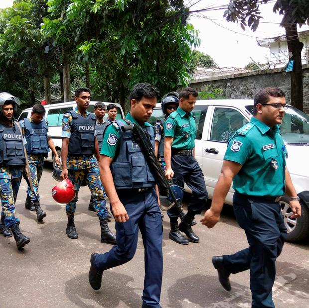 Security personnel are seen near the Holey Artisan restaurant hostage site, in Dhaka, Bangladesh REUTERS/Mohammad Ponir Hossain
