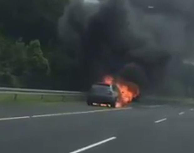The car in flames (image via @marksf35)