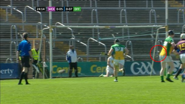 The sliotar clearly hits the back stanchion of the goals