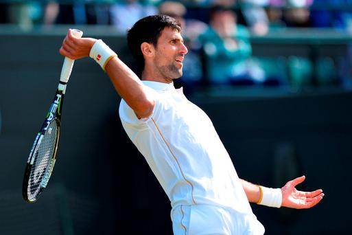Serbia's Novak Djokovic reacts as he returns to US player Sam Querrey during their men's singles third round match on the sixth day of the 2016 Wimbledon Championships at The All England Lawn Tennis Club in Wimbledon