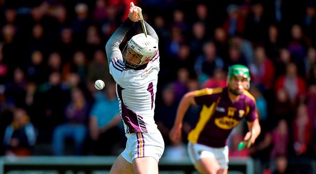 Wexford goalkeeper Mark Fanning strikes the sliothar as he shoots a penalty during the GAA Hurling All-Ireland Senior Championship Round 1 match between Wexford and Offaly at Innovate Wexford Park in Wexford. Photo by Matt Browne/Sportsfile