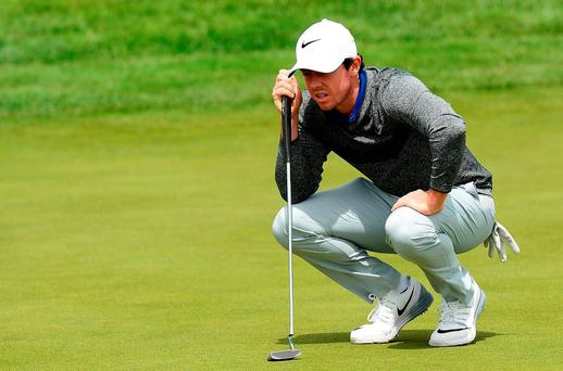 Rory McIlroy of Northern Ireland lines up a putt during the third round of the 100th Open de France at Le Golf National in Paris, France. (Photo by Richard Martin-Roberts/Getty Images)